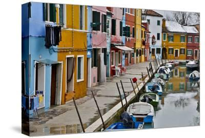 Boats Docked Along Canal with the Colorful Homes of Burano, Italy
