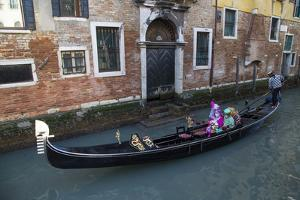Couple Dressed for Gondola Ride Venice at Carnival Time, Italy by Darrell Gulin