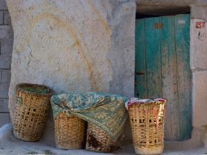 Doorway with Basket of Grapes, Village in Cappadoccia, Turkey by Darrell Gulin