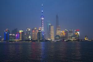Evening Light and Neon Colors of New Shanghai Reflected in Water by Darrell Gulin