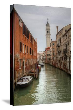 Leaning Bell Tower Along Venetian Canal, Venice, Italy