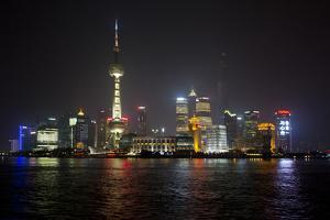 Shanghai, China, Evening Cityscape and Lights with River Reflection by Darrell Gulin