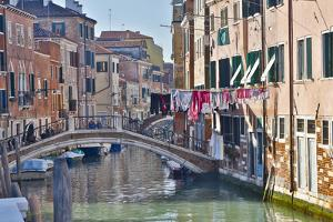 Work Boats and Bridge Along Canals of Venice, Italy by Darrell Gulin