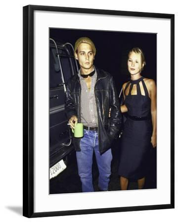 Actor Johnny Depp and Model Kate Moss at a Book Party at Danzinger Gallery