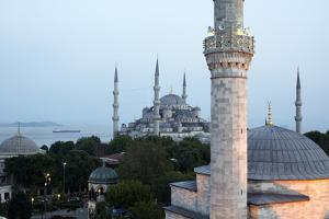 A Minor Minaret, Foreground, Competes with the Blue Mosque Dominating the Skyline by Dave Yoder