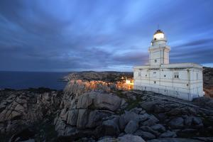 Lighthouse At Capo Testa, Near Santa Teresa Di Gallura, On Sardinia's Northernmost Headland by Dave Yoder