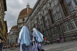 Nuns Walk Past the Basilica Di Santa Maria Del Fiore, Crowned by the Brunelleschi Cupola by Dave Yoder