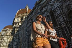 People Passing the Basilica Di Santa Maria Del Fiore, Crowned by the Brunelleschi Cupola by Dave Yoder