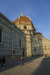 People Walk Past the Basilica Di Santa Maria Del Fiore, Crowned by the Brunelleschi Cupola by Dave Yoder