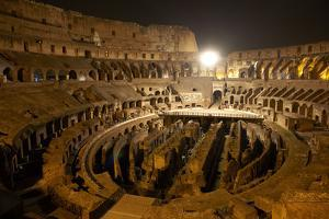 Rome's Colosseum and Hypogeum At Night by Dave Yoder