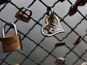 Locks on the Bridges of Paris are Quite Popular for Couples to Manifest their Wish for Eternal Love by David Bank