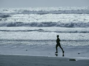 A Person Jogs Along the Beach by David Boyer