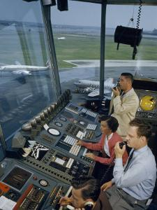 Air Traffic Controllers Direct Traffic from a Radio Console by David Boyer