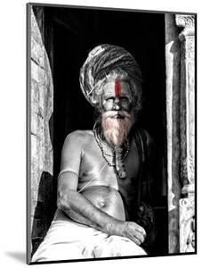 A black and white picture of a sadhu (yogi) at Pashupatinath Temple in Kathmandu, Nepal by David Chang