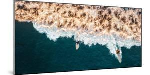 Aerial drone photo of surfers riding Pacific Ocean waves in San Diego, California at Sunset Cliffs by David Chang