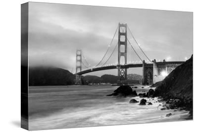 Cloudy sunset, ocean waves in San Francisco at Golden Gate Bridge from Marshall Beach