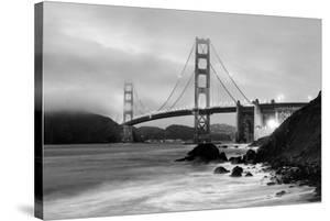 Cloudy sunset, ocean waves in San Francisco at Golden Gate Bridge from Marshall Beach by David Chang