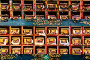 Color wall of books at buddhist monastery in Tengboche, Nepal on the way to Everest Base Camp by David Chang