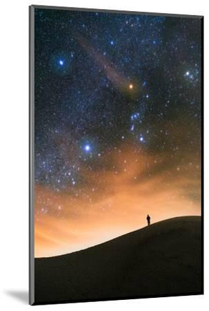 Colorful stars sky in White Sands Monument over Sand Dunes with silhouette and horizon air glow by David Chang