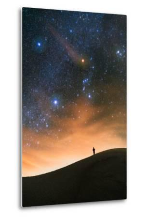 Colorful stars sky in White Sands Monument over Sand Dunes with silhouette and horizon air glow