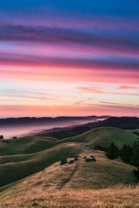 Colorful sunset with pink clouds on Mt. Tam in San Francisco with rolling, golden hills by David Chang