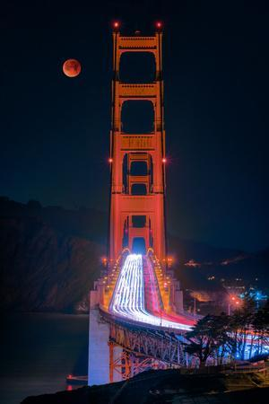 Full blood red moon rising over the Golden Gate Bridge in San Francisco, view from Battery Cranston