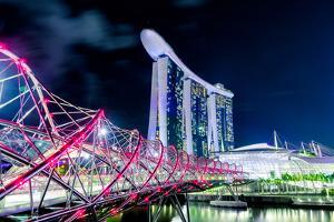 Marina Bay Sands and Helix Bridge city lights at night in Singapore with water reflections by David Chang