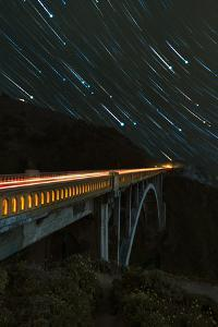 Star trails and light trails over the Big Sur's Bixby Creek Bridge near Monterey, California by David Chang