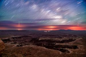 Star trails and Milky Way from Grand View point in Canyonland National Park near Moab, Utah by David Chang