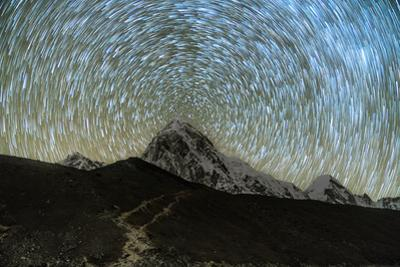 Star trails over Pumori Peak in the Himalayas, Nepal hiking to Everest Base Camp from Gorak Shep