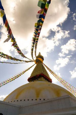 Stupa (Buddhist Temple) with colorful prayer flags in Kathmandu, Nepal by David Chang