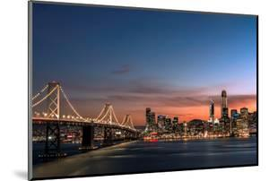 Sunset view of San Francisco from Treasure Island of the Bay Bridge with pink clouds at blue hour by David Chang