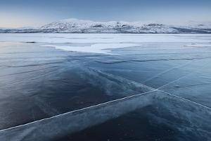 A Frozen Lake, So Clear its Possible to See Through the Ice, Near Absiko, Sweden by David Clapp