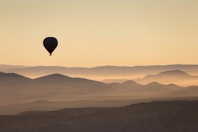 Single Hot Air Balloon over a Misty Dawn Sky, Cappadocia, Anatolia, Turkey, Asia Minor, Eurasia