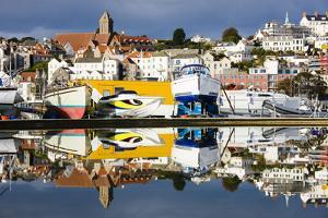 St Peter Port and Harbour Side Boats Reflected in a Model Boat Pond, Guernsey, Channel Islands, Uk by David Clapp