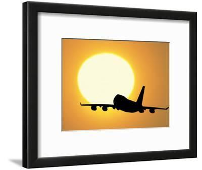 Silhouette of Airplane with Sun