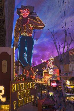 The Famous Ivegas Vici Neon Cowboy Stands among Other Signs on Fremont Street in the Iglitter Gulch