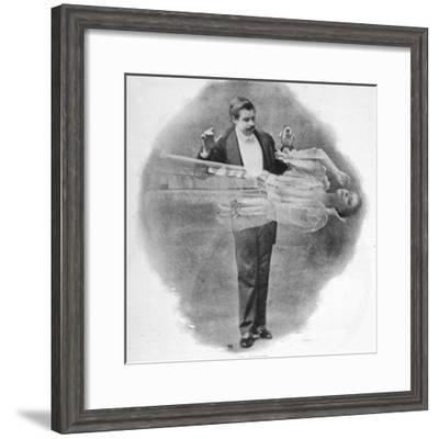 David Devant (Born 1867) in the Process of Making a Young Lady Disappear--Framed Photographic Print