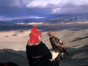 A Kazakh Eagle Hunter with His Bird in the Winter by David Edwards