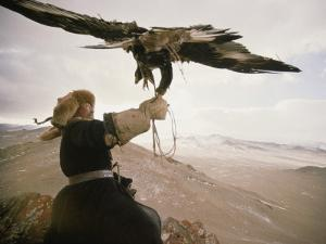 Kazakh Hunter Strains to Support a Golden Eagle by David Edwards