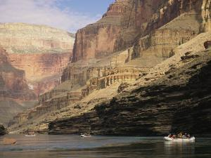 The Walls of the Grand Canyon Dwarf Inflatable Rafts on the River by David Edwards