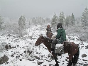 Two Horsemen Riding in a Late Summer Snow Storm in Western Mongolia by David Edwards