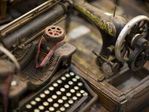 Antique Typewriter and Sewing Machine in a Shop by David Evans