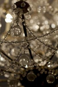 Close Up of an Ornate Chandelier at the Musee Carnavalet by David Evans