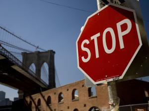 Stop Sign and the Brooklyn Bridge by David Evans