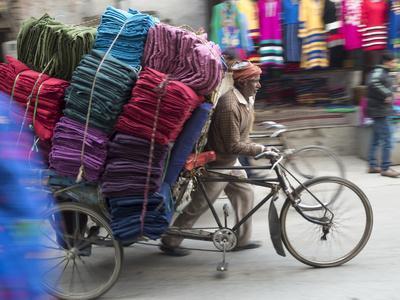 Cycle Rickshaw with a Big Load of Clothes in Amritsar, Punjab, India