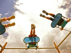 Children Playing on Swings from Below by David Hannah