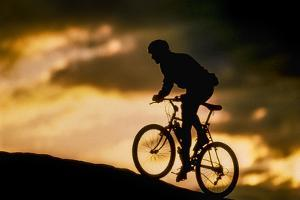 A Mountain Biker on Slickrock Trail Near Moab, Utah by David Hiser
