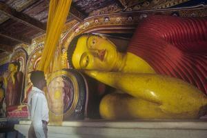 Reclining Buddha Sculpture at Anuradhapura, Sri Lanka by David Hiser