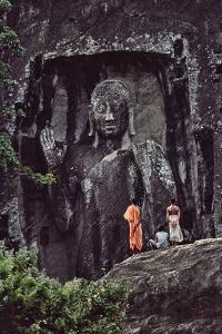 The Sasseruwa Buddha, or Ras Veheranear, Near Avukana, with a Buddhist Monk and Two Men by David Hiser